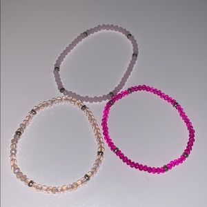 3 different shades of pink stretchy bracelets